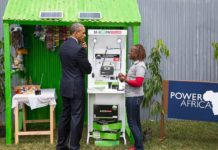 Obama at an MKOPA Solar Display Stand in Kenya