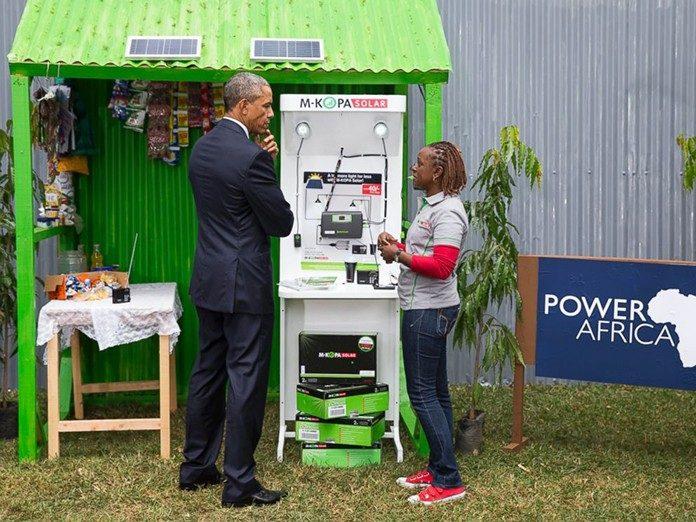 Obama at an MKOPA Solar Display Stand in Kenya