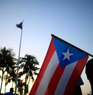 Puerto Rico Man Carrying Flag