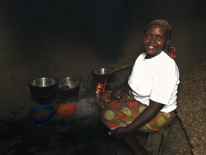 Tanzanian Mama Cooking Ugali