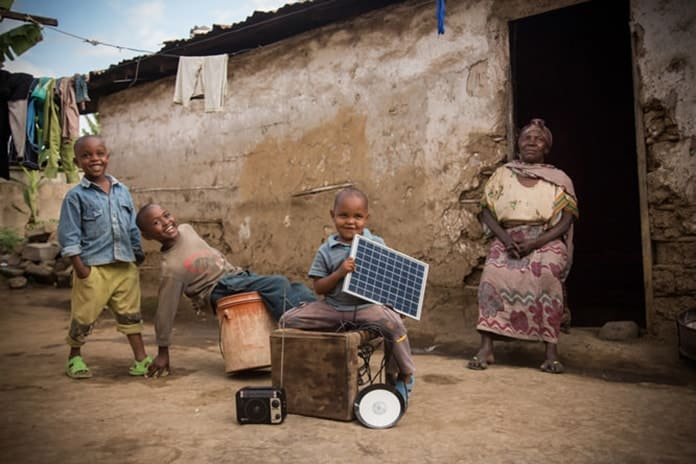 African Kids Using Lights Powered by Off-Grid