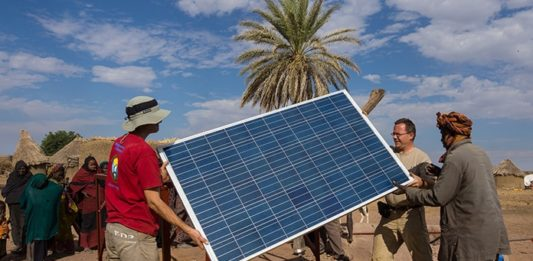 Solar Achievements in Africa: People Installing Solar Panels