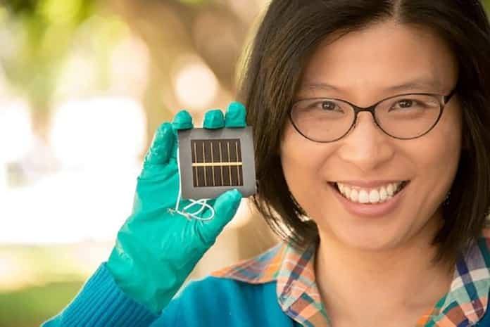 Anita Ho-Baillie Holds a Perovskite Solar Cell
