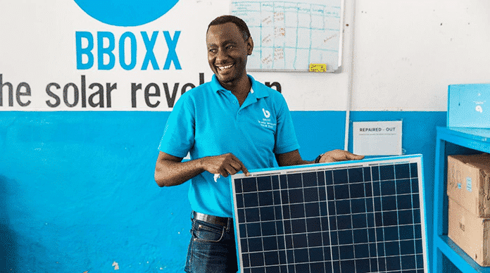 BBOXX Togo Employee With Solar Panel