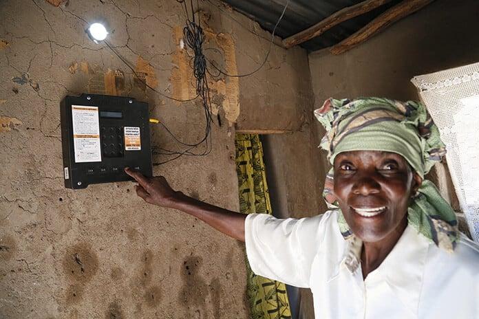 Elizabeth Mukwimba, a Solar Customer in Tanzania Using Smart Meter