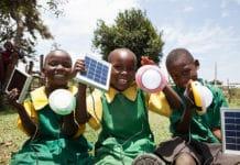 Primary School Children in Kenya Holding Solar Lights