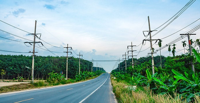 Thailand's Electricity Grid Along Countryside Road