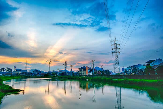 Electricity Transmission Towers at Sunset in Urban Indonesia