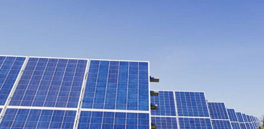 Solar Power Panels on Green Grass