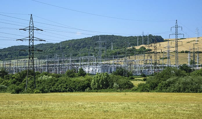 Utility Electric Towers on Green Grass