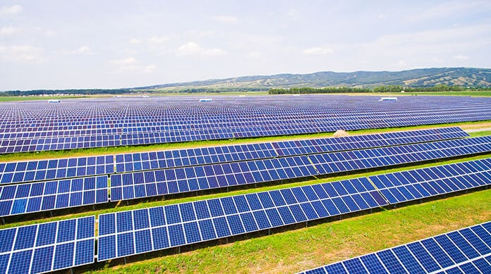 Off-Grid Solar Arrays Installed on Green Grass in Africa