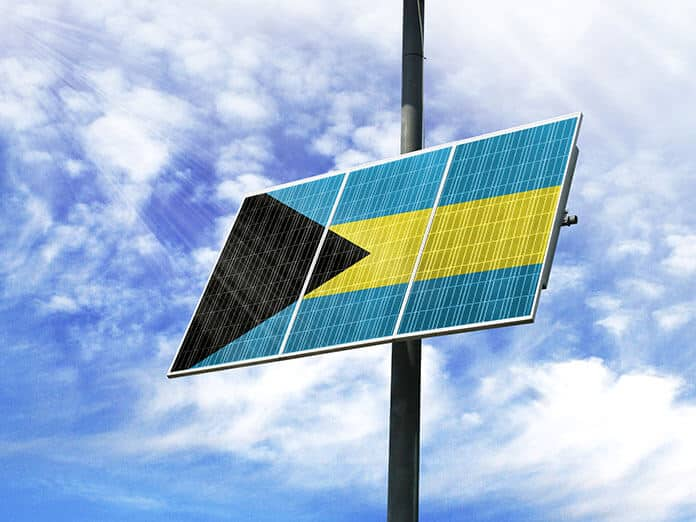 Solar Panel Against a Blue Sky with a Picture of the Flag of Bahamas