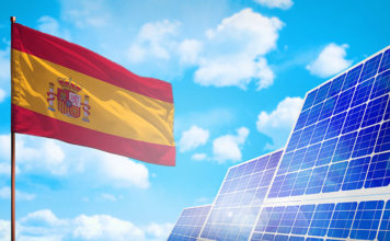 National Flag, Solar Panels and Blue Sky: Solar Energy Development in Spain