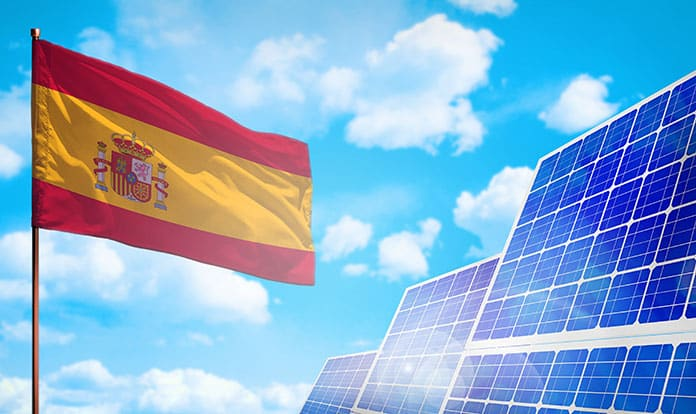 National Flag, Solar Panels and Blue Sky: Solar Energy Development in Spain