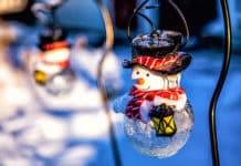 Solar Christmas Lights: Solar-Powered Snowman Light Hanging on the Snowfield