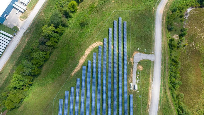 Aerial View of Community Solar Array on Green Grass