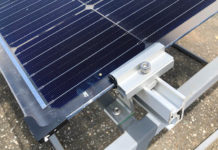 Testing of Bifacial Solar Panels With Reflected Light of Installed Roofs