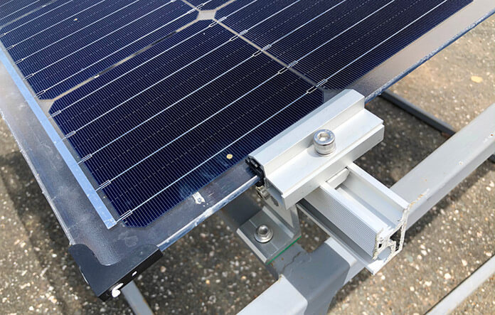 Testing of Bifacial Panels With Reflected Light of Installed Roofs