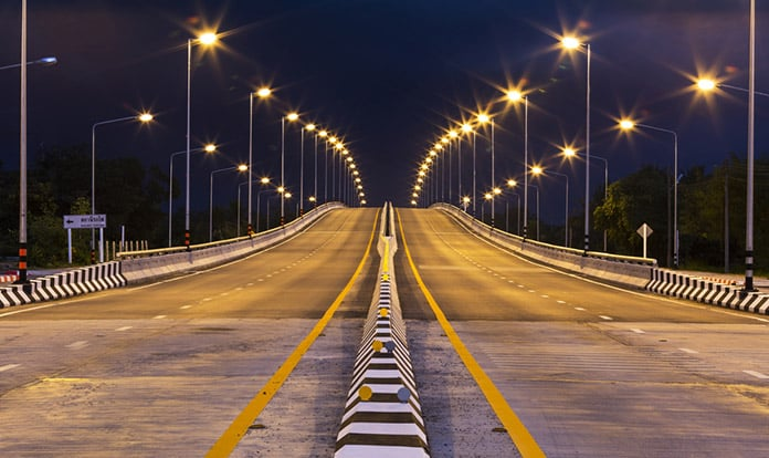 Conventional Street Lights Along Highway at Night