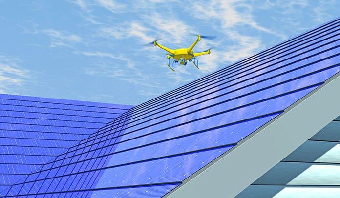 UAV Drone Inspecting the Installation of Solar Roof Shingles