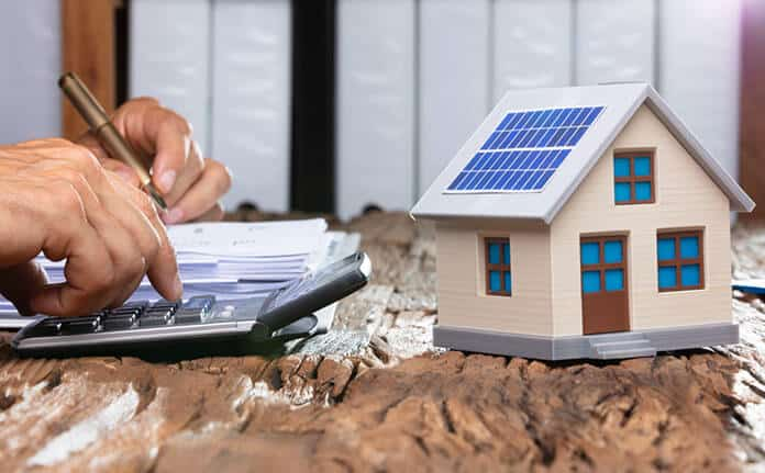 House Owner Calculating His Budget for Solar-Powered Roof Investment