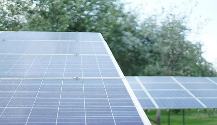 Blue and Gray Solar Panels Installed in Community Solar Plant