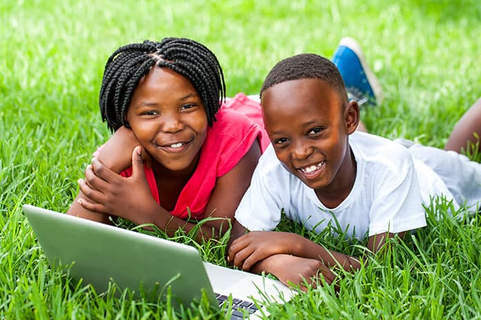 Off-Grid Powered Internet Access to Bridge the Digital Divide: African Kids Using Laptop, Connecting to the Internet
