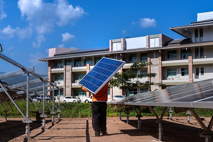 Installer Optimizing Ground-Mounted Solar Panels to Improve Efficiency and the Investment