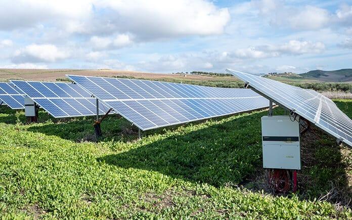 Solar Panel Installations on Green Grass Under Sunshine