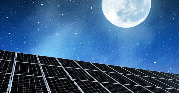 Solar Panels at Night Under the Moon