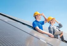 Workers at Solar Power Plant Looking Into the Sun